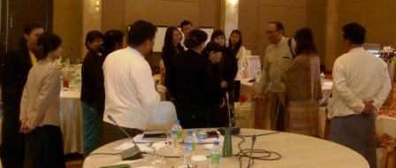 Dr Zaw Oo, CESD Executive Director, and representatives from union, state and region governments talk informally after the public financial management workshop