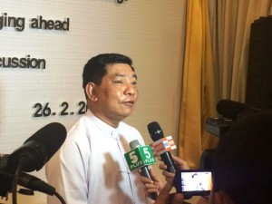 U Myo Aung, Permanent Secretary, Ministry of Labour, Employment and Social Security (MoLES), answers questions from the media during a break in discussions